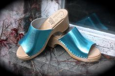 Skåne Toffeln Slip in clogs with turquoise metallic leather