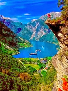 Geiranger Fjord, Norway a 15-kilometre (9.3 mi) long branch off of the Sunnylvsfjorden, which is a branch off of the Storfjorden (Great Fjord).  This fjord is surrounded by the steepest and the most preposterous mountains on the entire west coast. It is very narrow and has no habitable shore area, for the precipitous heights rise in sheer and rugged strata almost straight out of the water. Foaming waterfalls plunge into the fjord from jagged peaks