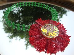 Red Poppy Flower from Seed Beads and Czech glass button with green cats eyes.
