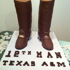 An Aggie groom's cake, topped with edible senior boots.
