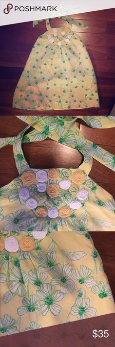 Lilly Pulitzer silk halter top with 3D flowers This halter top is gorgeous! Soft yellow silk with green and white flowers and these beautiful 3D flowers at neckline! Someone needs this beauty! Freshly dry cleaned! Lilly Pulitzer Tops