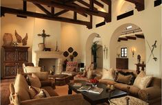 Spanish Colonial interior: I love the cross, the giant wooden armoire, the exposed wood beams, and the huge fireplace.