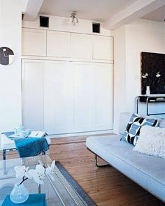 Queen size Murphy bed hidden in the wall! Old concept with a modern twist. The molding details help integrate the entire looke into the room.