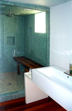 don't need the steam shower, but like the river rock bottom and the blue tile, cut out and rain shower