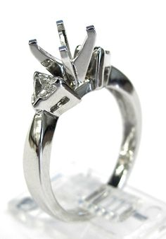Ladies 14kt white gold semi mount. Mounted in ring are 2 trillion cut diamonds weighing a total of 32ct. Mounting is made to take any size and shape diamond in the center.