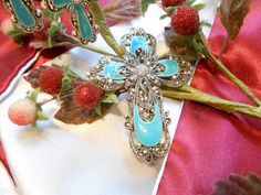 Check out this item in my Etsy shop https://www.etsy.com/listing/255793521/vintage-style-enamel-marcasite-crystal