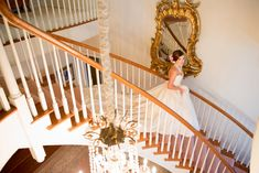 Southern Magnolia Bride on staircase at Jubilee Hills in Lewisburg, TN. Lea-Ann Belter dress. Pink, gold, and ivory create the most feminine and stunning classic look for this bridal portrait. Photo by Twila's Photography