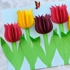 Gorgeous 3D Paper Tulip Flower Craft stems could be washi tape; use scrapbook paper; Gorgeous 3D Paper Tulip Flower Craft | I Heart Crafty Things<br> This colorful paper tulip flower craft makes a great spring kids craft or spring flower craft for kids. It also makes a great Mother's Day craft for kids. This pretty flower craft is easy to make and you will love how the 3D paper tulips and folded stems pop off the page. Easy Easter Crafts, Mothers Day Crafts For Kids, Summer Crafts For Kids, Easter Crafts For Kids, Summer Kids, How To Make Paper Flowers, Paper Flowers Diy, Flower Crafts, Craft Flowers