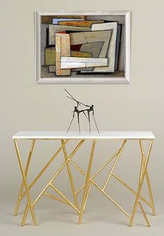 On the otherside of the design spectrum there is a Adam Williams geometric console. Its base, composed of several thin tubes, finished in gold are complimented with a clean white surface.