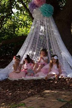 Hang your own lawn tents made from lace curtains or sheets.