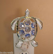 "SWAROVSKI BLUE CRYSTAL ELEMENTS ""SEA TURTLE"" NIGHT LIGHT SILVER PLATED... I have this in green crystal..."