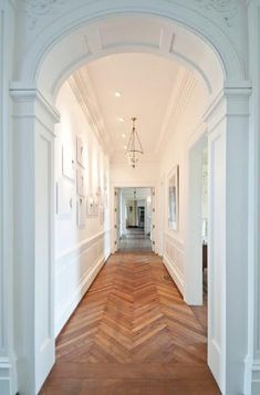beautiful hallway...love the herringbone floor