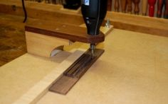 Dremel Routing Table - Homemade Dremel routing table constructed from MDF, plywood, screws, and wing nuts.