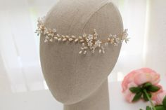 ❀ ANNABELLE BOHEMIAN STYLE WEDDING HALO ❀  The dainty Annabell wedding hair vine has a totally organic feel with hand made cold porcelain flowers, glittering Swarovski crystals & assorted glass & faux pearls. It is mounted on a strong yet flexible wire base which can easily be shaped to suit your chosen hair style. Can be fixed into place with pins or a pretty ribbon. ~ Measures: 5 cm at widest point. ~ Colour Pallet: White, Ivory & Cream.  Annabelle is available in 3 length optio...