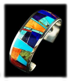 Beautiful Contemporary Multi Color Inlay Bracelet I would love to own. The stone combination in this cuff reminds me of stained glass...