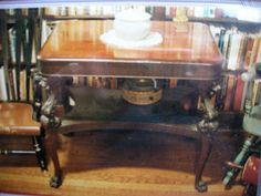 """Gryphon Table in dark cherry dating to c1890 and featuring awesome, carved Gryphons (4) and flourishes on knees and the back of the legs and table supports underneath the table.  http://stores.ebay.com/LUCKY-STARS-CAT-IN-THE-HAT/PICKUP-ONLY-furnitureOR-large-/_i.html?_fsub=1368097017&_sid=6744627&_trksid=p4634.c0.m322  IT'S ALL ABOUT THE """"JOURNEY"""".    *Latin for today.  """"Heu! Tintinnunitius Meus Sonat!    (Darn! There goes my beeper! ^.^)"""