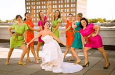 Love the mix of bright colors on these bridesmaids' dresses