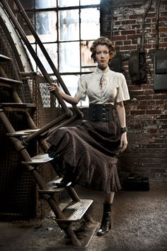 Love the soft blouse, leather cincher and ruffled hem skirt.
