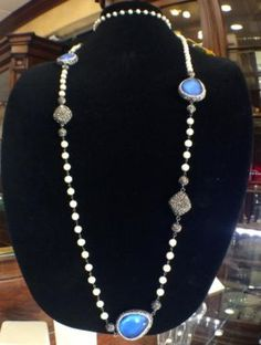 Mother of Pearl, Lapis Beads and Swarovski Crystals Necklace  $620  Harold's Diamonds and Jewelry  1228 W. Main St.  Lewisville, TX 75067  Harold's buys and sells estate jewelry!  Now with t