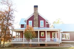 Gorgeous barn red new American farmhouse. #carltonlanding #newurbanism www.pencilshavingsstudio.com