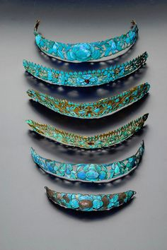 SIX CHINESE GILT METAL AND KINGFISHER FEATHER HEAD BANDS; QING DYNASTY (1644-1912, 1917) each decorated with reticulated designs of flowers, leaves and butterflies, one mounted with coloured beads, 21.5cm max. (6)