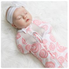 The Woombie is the safest, most natural way to swaddle your baby.  Made out of yoga pant material so baby can still move arms and legs around but securely