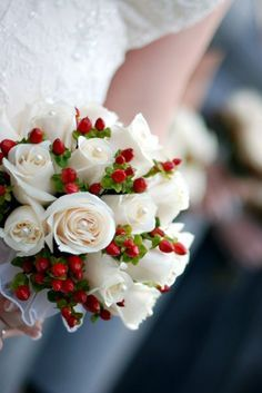Winter wedding ideas christmas greens with pine cones white roses ...