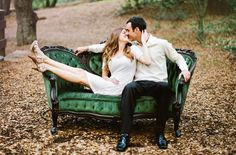 beautiful green couch for an engagement photo
