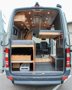"Van Life Guide Van Life Guide In ""Graystone"", a fold down bed is securely lowered onto chains for the second explorer. The bed can be folded and secured to the wall to open up interior space. 🛠 📷 by Freedom Vans Van Conversion Interior, Camper Van Conversion Diy, Camping Klo, Fold Down Beds, Kombi Motorhome, Kombi Home, Sprinter Van Conversion, Ford Transit Conversion, Sprinter Camper"