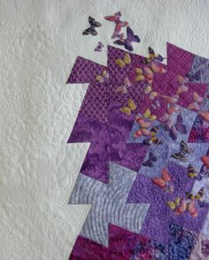 Very creative juxtaposition of patchwork and realism. [Purple Butterflies - Contemporary Bed Throw, Lap Quilt or Wall Hanging Sized Patchwork Quilt]