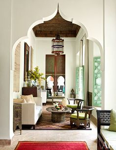 At one end of the living room, a table draped with a Kurdish kilim from Iran faces a Syrian daybed and star-shaped side table; the rugs are Moroccan.