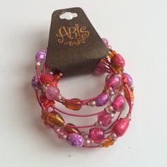 NWT Aris Wire Wrap Bracelet Pink fuschia and purple colors in a wrap style bracelet made by Aris. No trades. Generous discount with bundle. Aris by Treska Jewelry Bracelets