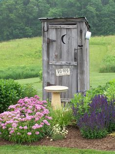 Would use this to house all my gardening tools. <3 would love to have this outhouse in my garden...so so cute!!