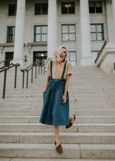 overall skirt | loose outfit | neutral colors | short blonde hair | outside | long skirts | tee shirts