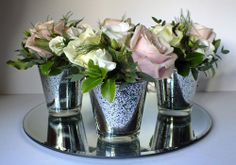 Beautiful vintage votives filled with classic pink and ivory roses