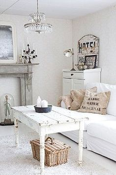 Beautiful white shabby chic living room. - http://myshabbychicdecor.com/beautiful-white-shabby-chic-living-room/