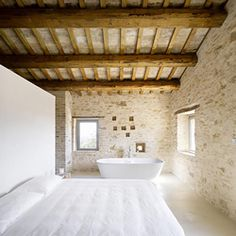 Casa Olivi is a beautiful renovation by Wespi de Meuron Architects, the 300 year old farm is located in Treia, in the heart of Tuscany.