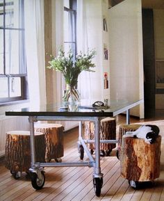 Tree Stumps on rollers to serve as table seating...awesome idea!