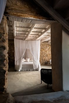 = stone, beams and net = renovated Greek fisherman's house = The Style Files *and the Style Files kicks arse*