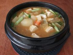 Doenjang jjigae (Korean soybean paste and vegetable stew). Spicy, salty, and vegetarian! (Anchovies and shrimp are not necessary if you want to make it vegan).     Also, this website has really awesome Korean recipes
