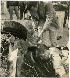 "Director John Frankenheimer covers actor Brian Bedford in blood for the accident at Monaco from ""Grand Prix"" 1966"