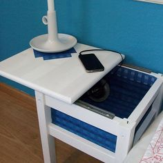 So clever!  The sliding top to this bedside table means you don't have to take everything off to get inside, and it's a good way to hide those necessary bits & pieces.
