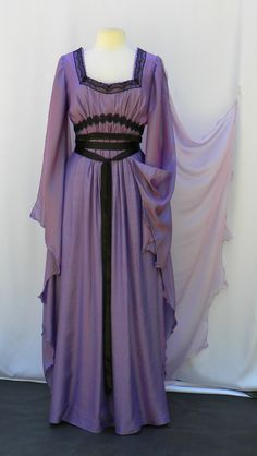 An interesting Halloween fancy dress in two tone purple pink, soft falling with a chiffon cape attached. This Lily Munster cosplay dress for women is a most elegant choice with black lace trimming decorations and accent satin bands. #LilyMunster #halloweencostumes Lily Monster, Lily Munster Costume, Chic Dress, Dress Up, Celebrity Halloween Costumes, Dress Tutorials, Cosplay Dress, Halloween Fancy Dress, Outfits