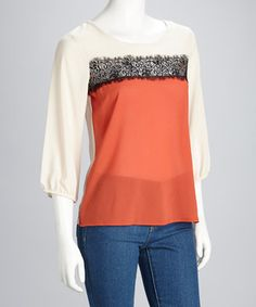 Make a statement with this bold top. The color block design is highlighted by the black floral lace for a feminine touch while the three-quarter sleeves feature slightly stretchy cuffs to be pushed up the arms or flow free.