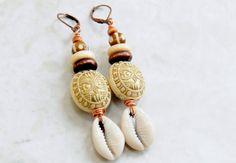 African Cowrie Shell Dangle Earrings, Tribal Earrings, Ethnic Jewelry, Shell Earrings. $18.00 USD All natural beads . Earrings measure 2.5 inches long. Peace & Blessings Ships worldwide from Atlanta, Georgia