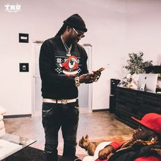 """2 Chainz's """"Dabbin' Santa"""" Christmas sweater seemed like a genius idea to most, but just how genius may come as a surprise.  The trendy play on the holiday """"ugly sweater"""" trend earned the rapper a cool $2 million in revenue, according to his new interview with Forbes.  One way of giving back was 2 Chainz"""
