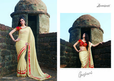 Get the ultimate ethnic look by draping this pretty saree that will emblazon your feminine look even further. Made to complement you in every way, this piece is a complete masterpiece. #Catalogue #GURJARI  Price - Rs.2654.00  #ReadyToWear #OccasionWear #Ethnicwear #GURJARI0816 #FestivalSarees #RakshaBandhan #Fashion #Fashionista #Couture #GiselleMonteiro