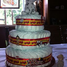 Diaper cake for baby shower!  Guess what Daddy does?!