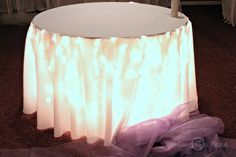 Goddess of Eats: Decorating a Cake Table With Lights and Tulle - A Tutorial, how to use white lights under a wedding cake table
