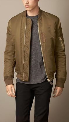 Burberry Brit Olive brown Lightweight Bomber Jacket - A lightweight bomber jacket with a heritage-inspired pen pocket on the arm. Lightly padded, the simple silhouette includes slant pockets and zigzag stitching at the front zip guard. Discover the men's outerwear collection at Burberry.com: